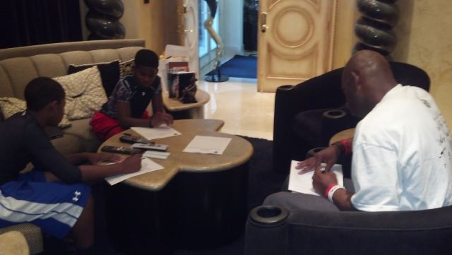 Deion Sanders filling out police reports with his kids